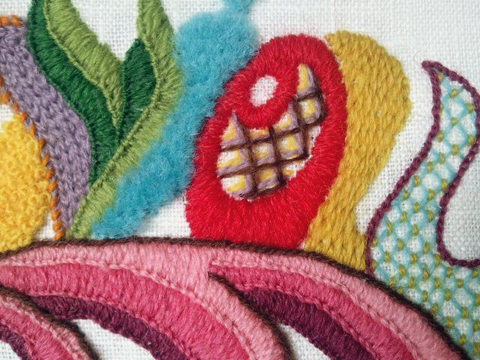 A sampler of a variety of filling stitches: in purple is chain stitch; green and pink, blankets stitch; blue, turkey knots; red, satin stitch; brown etc,  lattice; mustard, burden stitch ; light blue, couched lattice.