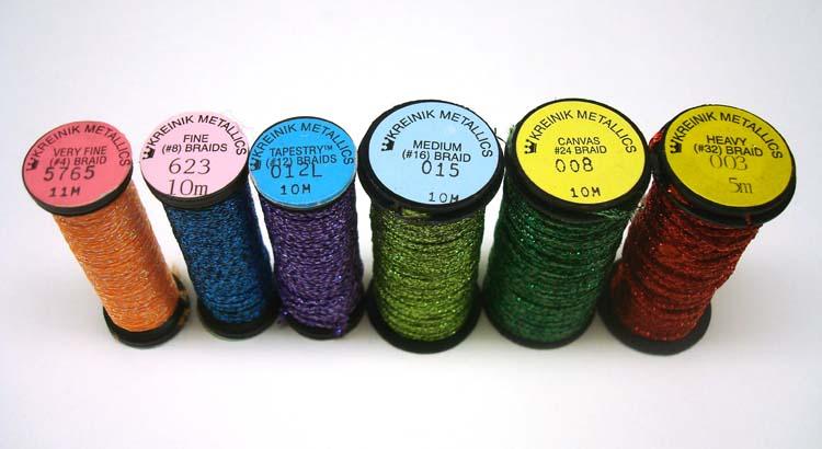 Kreinik makes metallic Braids (a soft, flexible, round thread) in different sizes.