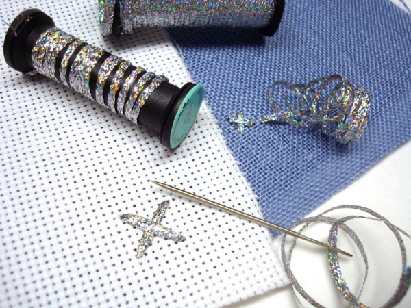 Kreinik has two sizes of metallic ribbons for stitching. Use your needle or finger to keep the ribbon flat as you place your stitch.