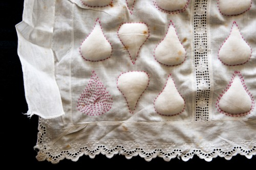 Image showing detail of art apron by Ruth Singer using trapunto and embroidery