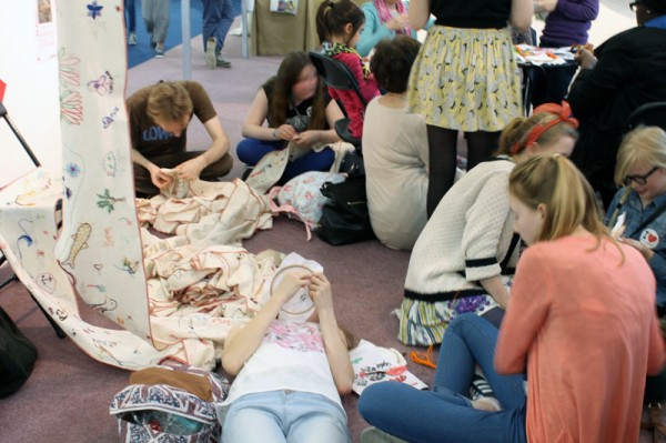 Stitching on the world's longest embroidery at the Mr X Stitch Inspiration Station
