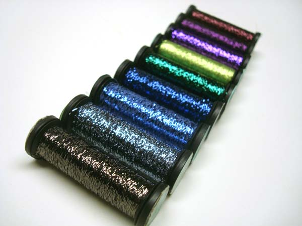 Colors of Kreinik Blending Filament that add the iridescence to stitched birds.