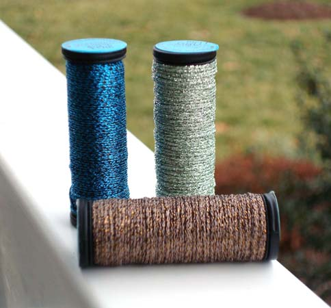 Metallics don't have to be over-the-top. These shades are three of the many muted colors available in the Kreinik metallic thread line, which add subtle shimmer to bird and nature designs.