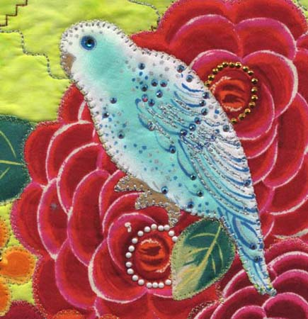 Beaded and embroidered bird by Cathie Hoover, using Kreinik metallic threads in the wings and outlines of the bird-themed fabric.