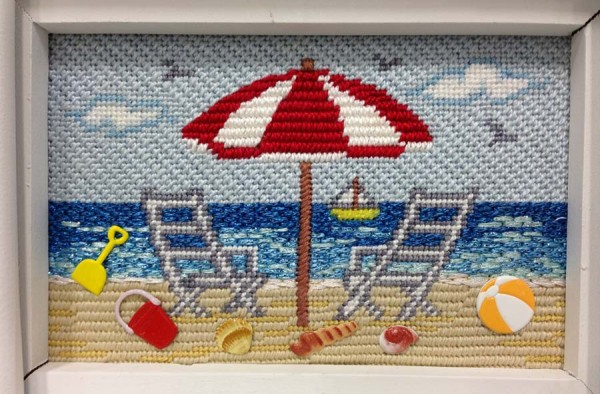 The ocean in this needlepoint canvas from Cheryl Schaeffer Designs was stitched with metallic threads to make it more realistic