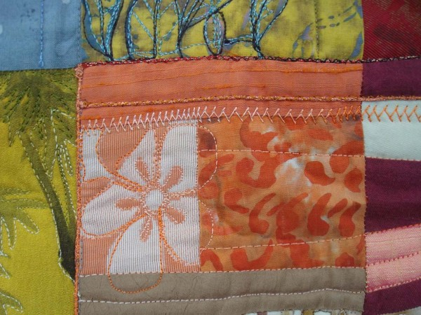 "Can we say this is a ""delicious"" blend of colors in Eleanor Levie's Pomegranates quilt? Fabrics of citrus colors add to the overall ""flavor"" of the piece."