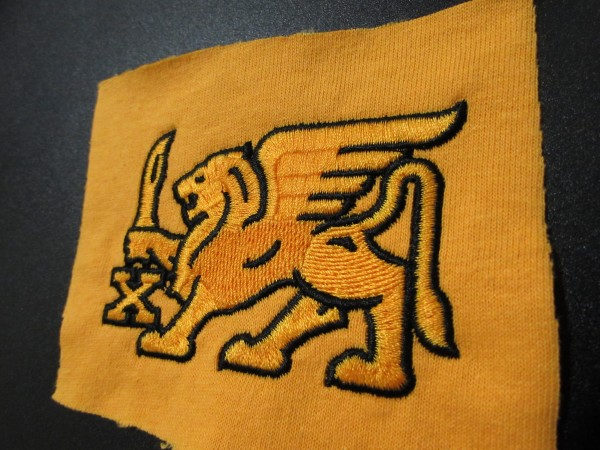 Winged Lion- Executed in Carved Satins and Curved Fills