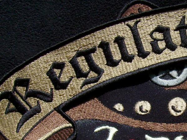 Regulators Text Closeup - Satin Stitches