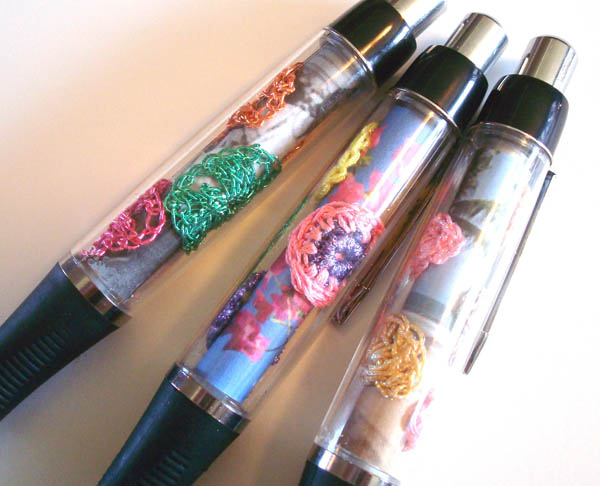 For these, I crocheted tiny shells and circles out of Kreinik Tapestry #12 Braid and Japan #5 thread (both good weights for small motifs). I added some photos for the backdrop, and glued them all into the Kreinik Make-A-Pen.