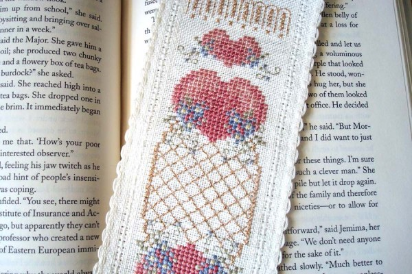 Designer Pam Kellogg created this cross-stitched bookmark using Kreinik silk and metallic threads on a piece of Zweigart band fabric. It's such a sweet design, reminiscent of old-fashioned stitched tokens, like the bookmarks you find in antique books.