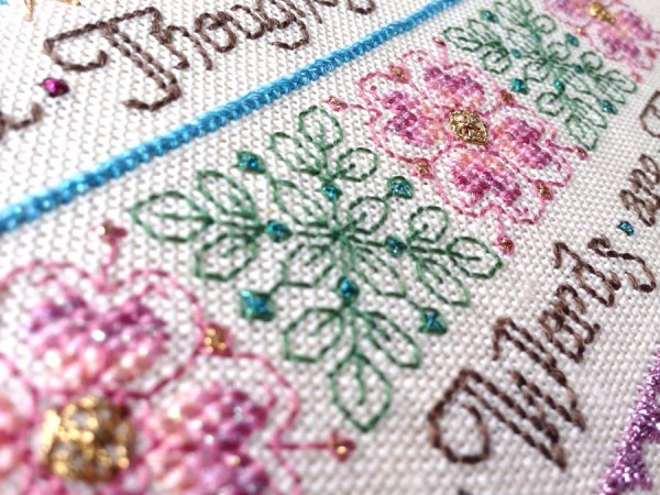 "Stitch the light fantastic. How? By using metallic threads. They catch the light and make designs ""dance."""