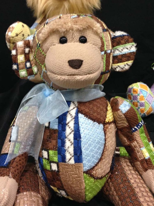 A design company like Sew Much Fun paints the pattern onto needlepoint canvas. It's almost like getting a painting, a work of art, which is why painted canvases can be so expensive. This Sew Much Fun pattern is called Mikey Monkey.