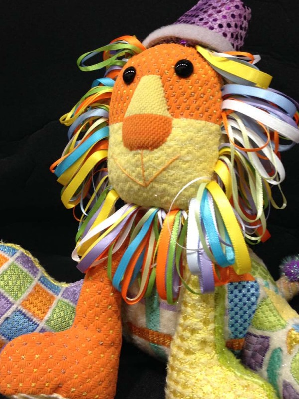 """Don't you love the ribbon mane on this design? It's a painted canvas needlepoint pattern from Sew Much Fun, called """"Lion King."""""""