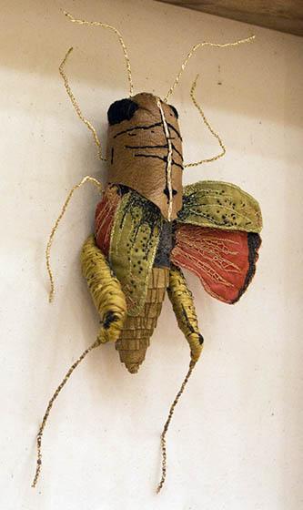 Embroidered grasshopper by Jenna Lagonigro