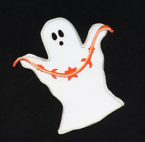 Glow-in-the-dark iron-on threads embellish a paper ghost.