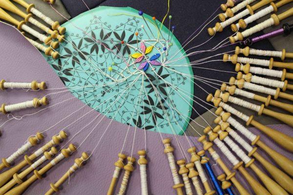 Colourful handmade Cluny bobbin lace Photo Credit: Elena Kanagy-Loux