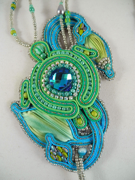 Shimmering Sea Turtle Lariat in Kiddie Pool, by Amee K. Sweet-McNamara