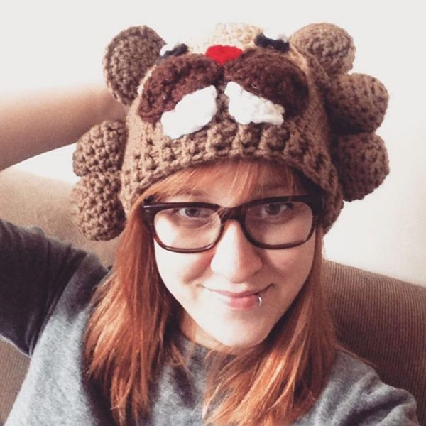 Her name is Kari Warning, and she stitches, she Twitches...she's like you and I (has a family, cats, friends, life) plus she designs cross stitch patterns under the name 8 Bit Stitching.
