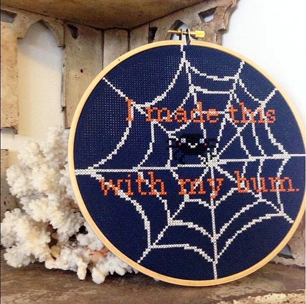 Looking at one of my favorite designs in Kari's line, don't you think this spider web would be awesome stitched in Kreinik's glow-in-the-dark color 052F?