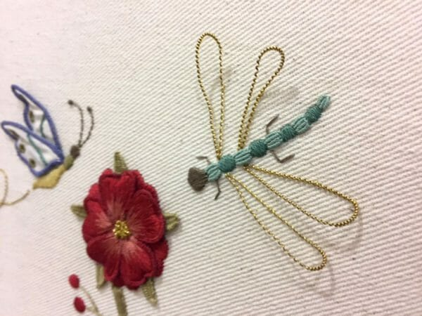 One of the most popular themes in needlework today is recreating bugs in stitches and threads. Look at the fabulous wings on this dragonfly! Project from the San Francisco School of Needlework and Design.