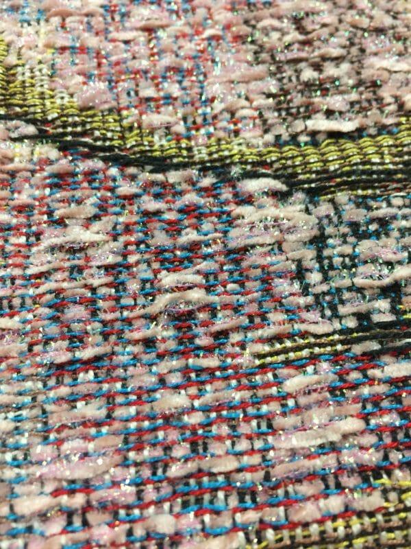 Close up of Kreinik's fuzzy pink metallic fiber. Design by Trey Gehring.