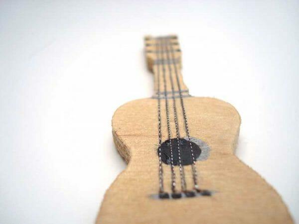 The very thin Kreinik Cord looks perfect as guitar strings on this dollhouse miniature.