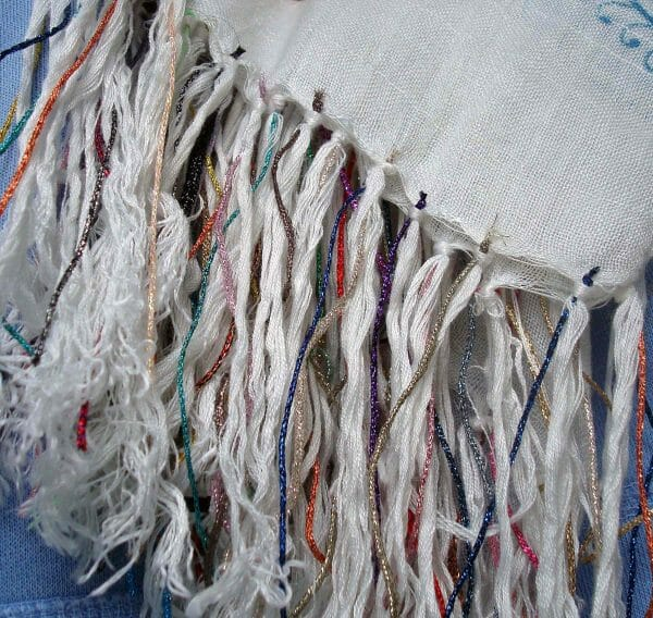 Tie one on! Adding metallic threads to a store-bought scarf makes it look a little more fun and interesting.