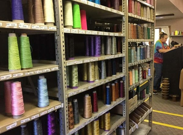 The factory is divided into the silk thread section, and the metallic thread section (shown here). Threads are made, coned, spools, labeled, and packaged in a gigantic room of color and music (could not help but tap my foot to some good classic rock playing in the room).