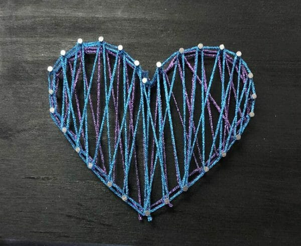 Can you see the layering of fibers in this string art heart? Just imagine the fun you have have with different kinds of threads. This design uses a few Kreinik thread types.
