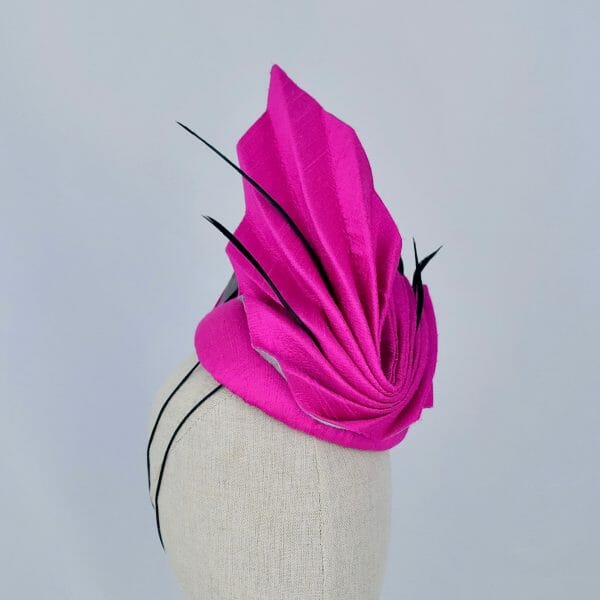 Bright pink hat by Sally Caswell