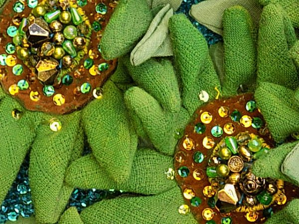 Petals are painted in 'Green Sunflowers' to give structure to the open weave cotton fabric.