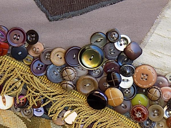 Creating textural depth in layering buttons