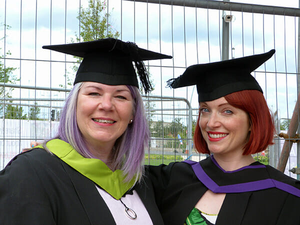 Suzanne Treacy on graduation day, with Amber butchart, fashion historian - photo by Chris Treacy