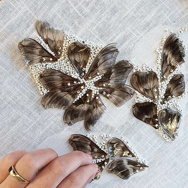 Stitching delicate moth wings and beads, Inge Tiemens, Hand & Lock Prize for Embroidery winner