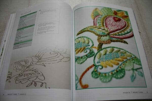 Crewel Embroidery: 7 enchanting designs inspired by fairy tales by Tatiana Popova - full two page spread example of a floral project