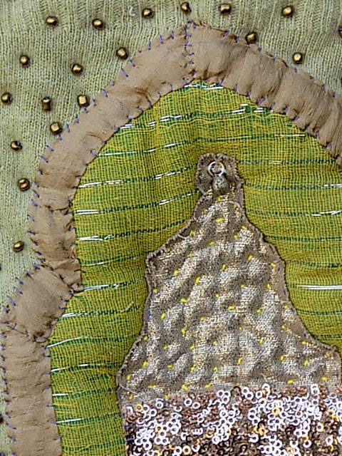 ABSTRACT INDIA - GOLD BUDDHA ON GREEN BACKGROUND, ADORNED IN JEWELS, BEADS AND SEQUINS