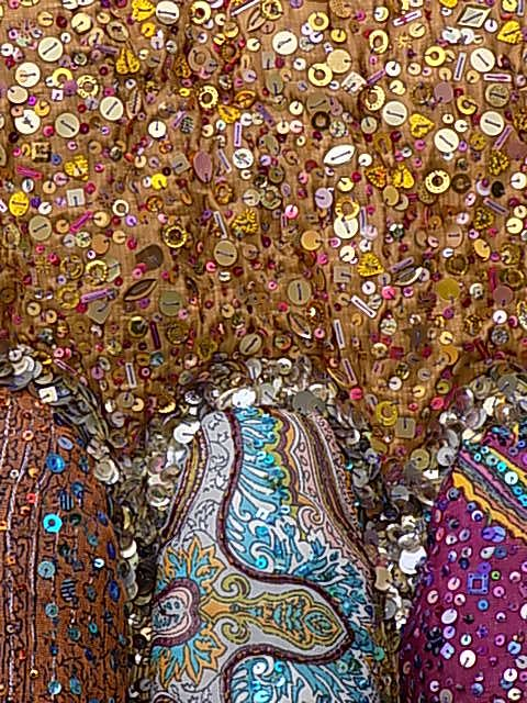 ABSTRACT INDIA - VIBRANT BUDDHA TEMPLE ADORNED IN LIGHT REFLECTIVE BEADS, SEQUINS AND MIRRORS