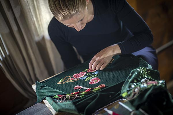 Embroidering poppies on her winning entry, Joanna Galica-Dorula