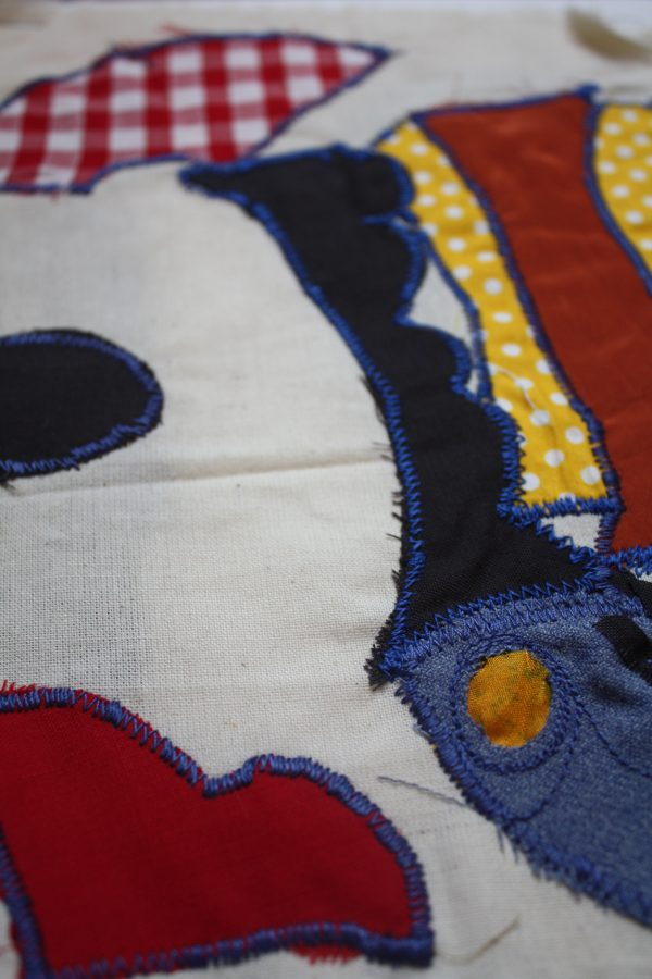 zig zag stitching holds down this applique piece, by machine not hand.